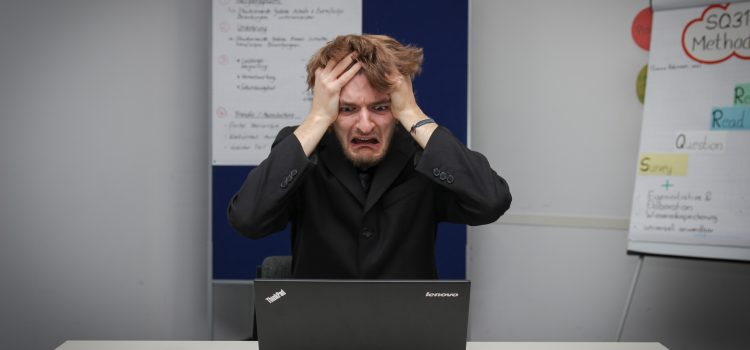Stressed out man in front of computer. Photo by Sebastian Herrmann on Unsplash
